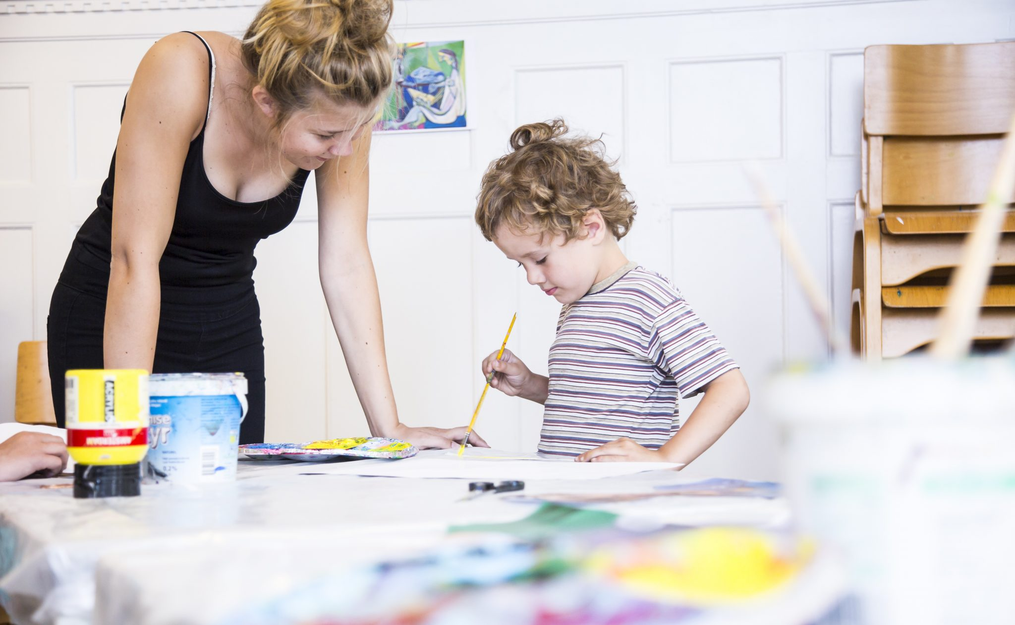 Boy painting at the School of Art