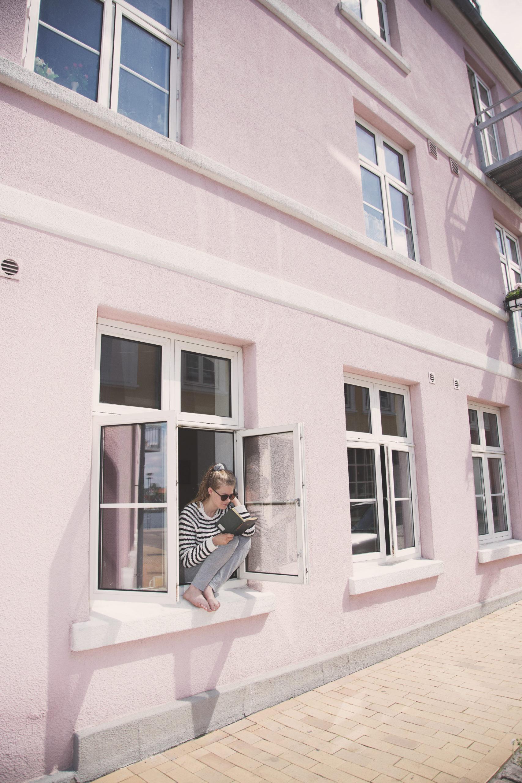 Girl reading in window